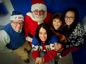 Dr. E and Staff with Santa